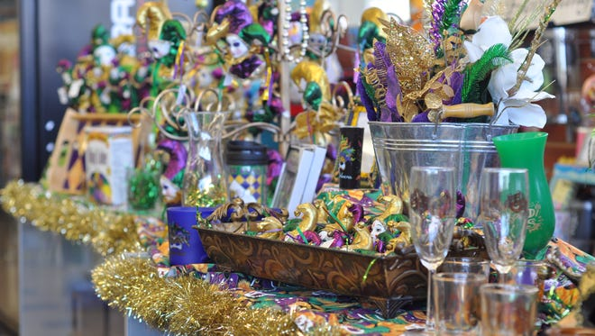 Shelves filled with Mardi Gras items at Sentry Grill & Drug in Alexandria.