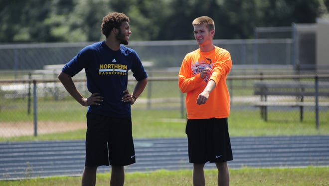 Michael Burrell (left) and Colby Nabozny share a laugh during practice in preparation for the AAU Junior Olympics on July 13, 2016.