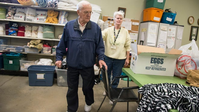 Roy Fenton and Sue U'ran set ready to sort donations at Swannanoa Valley Christian Ministry