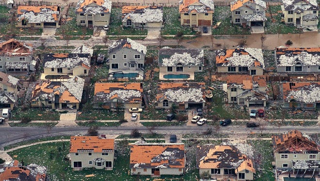 In this Aug. 25, 1992, file photo, rows of damaged houses sit between Homestead and Florida City, Fla. Almost 25 years after Hurricane Andrew struck south of Miami, a new insurance underwriters' analysis says the city's vulnerability to another Category 5 hurricane has grown exponentially.
