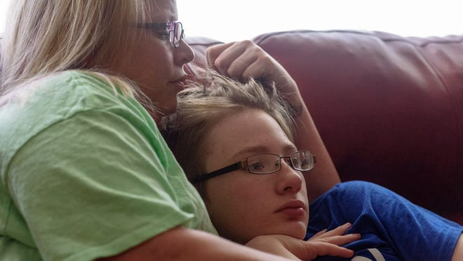As DaCota and his mom settle in for a Sunday afternoon movie, Jumanji, Tasha pulls her son in close to share the time together.Natasha Turpin, 34, a recovering meth addict, visits with her son DaCota Ascencio, 13, during a weekend visit from The Healing Place at her parentÕs home in Danville, Ky. March 25, 2018