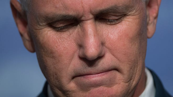 Republican vice presidential candidate, Indiana Gov. Mike Pence pauses while speaking to the Value Voters Summit in Washington, Saturday, Sept. 10, 2016.