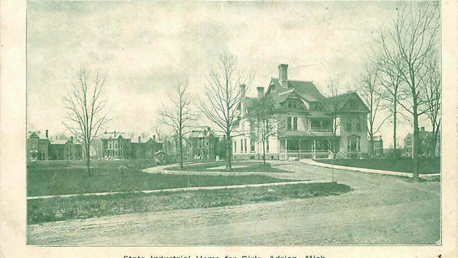 """The State Industrial School For Girls as it appeared in 1906 is pictured. The large building in the forefront is the Administration Building. The """"Cottage"""" in which the pupils lived can be seen in the background."""