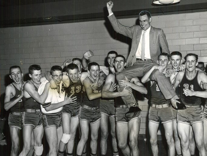 1959: Calumet coach Ray Knauer is lifted by his team