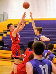 Cooper's Deven Bailey puts up a shot over a Canyon