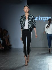 A model walks the runway at the Eva Longoria Collection