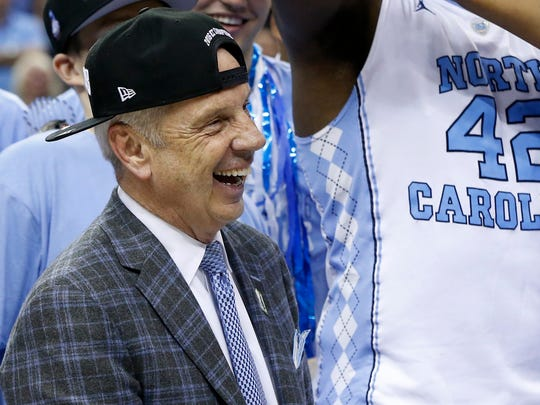 North Carolina Tar Heels head coach Roy Williams celebrates after the Tar Heels' victory over the Virginia Cavaliers in the championship game of the ACC conference tournament at Verizon Center. The Tar Heels won 61-57.