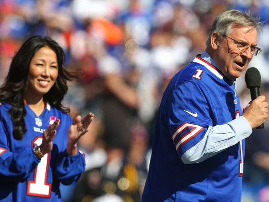 Owners of the Buffalo Bills, Terry and Kim Pegula, address the crowd before the team's game against the Patriots on Oct. 12, 2014.