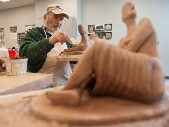 Frank Pandolfo of Vineland works on a sculpture in