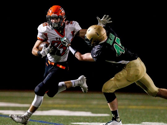 Vestal's Noah Socash tries to bring down Union-Endicott's Jack Thomas in the second quarter at Vestal's Dick Hoover Stadium on Friday, October 6, 2017.   Thomas La Barbera / Correspondent