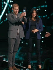 Duchess Meghan of Sussex wore wore black pants, a black top that showed off her baby bump and a royal blue blazer for her surprise appearance on stage with Prince Harry at WE Day UK at Wembley Arena in London, March 6, 2019.