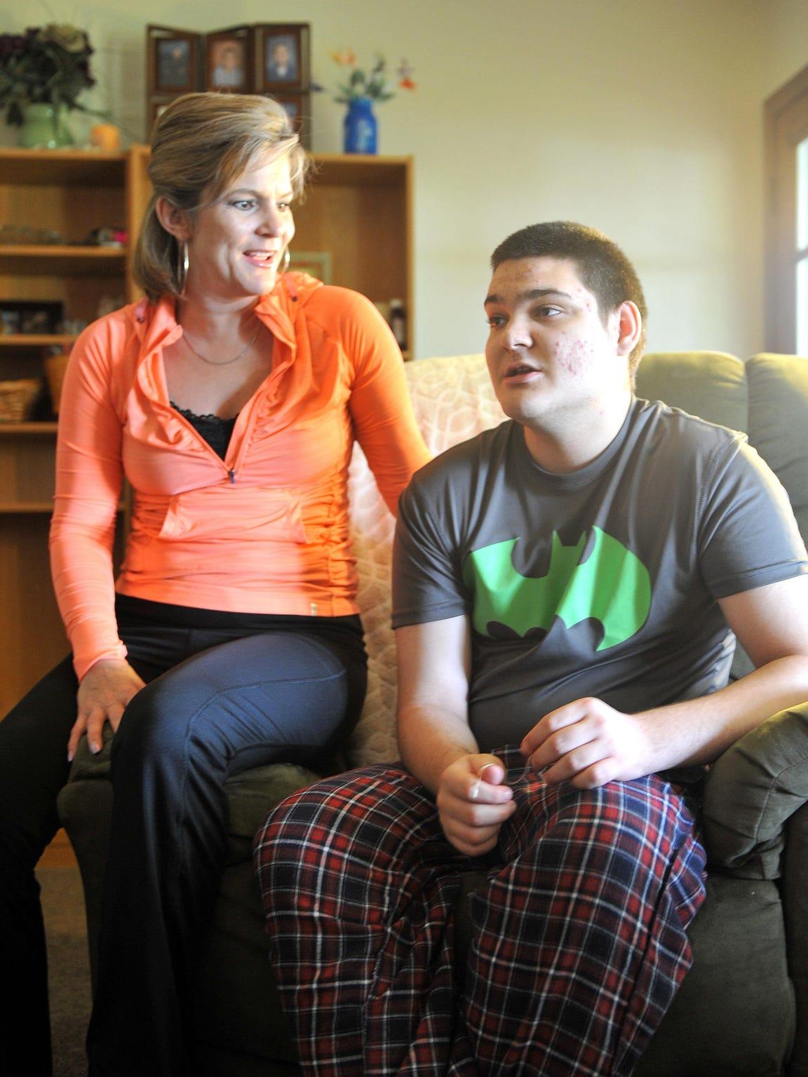 Roberta Doklovic sits next to her son, Zach Kauffman,