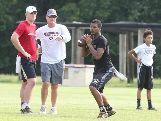 Christian Souffront looks to make a pass at Brandon Bea, left, and Riverdale coach Ron Aydelott watch.