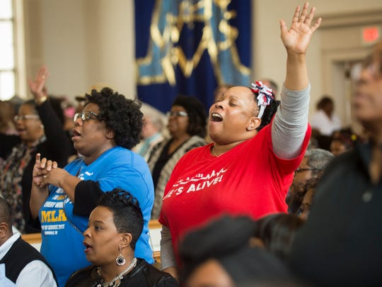 Members of the community sing together during the Dr. Martin Luther King Jr. memorial service program at Greater Warner Tabernacle AME Zion Church in Knoxville on Jan. 16, 2017.