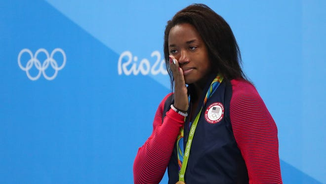 Simone Manuel (USA) on the podium after the women's 100m freestyle final in the Rio 2016 Summer Olympic Games at Olympic Aquatics Stadium.