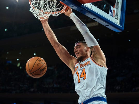 FILE - In this Nov. 11, 2017, file photo, New York Knicks' Willy Hernangomez dunks against the Sacramento Kings during the second half of a NBA basketball game at Madison Square Garden in New York. A person with knowledge of the deal says the Knicks have agreed to trade center Hernangomez to the Charlotte Hornets. The person says the Knicks will receive a pair of second-round picks and Johnny O'Bryant in the deal that was agreed to Wednesday, Feb. 7, 2018, the day before the NBA trade deadline. The person spoke with The Associated Press on condition of anonymity because the trade is not yet official. (AP Photo/Andres Kudacki, File)