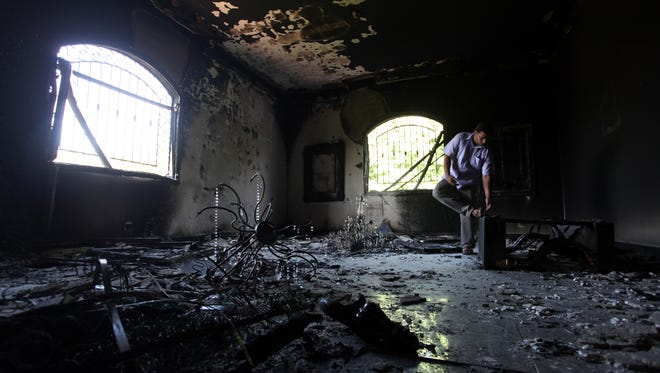 A Libyan man investigates the inside of the U.S. Consulate after an attack that killed four Americans, including Ambassador Chris Stevens, on the night of Sept. 11, 2012, in Benghazi, Libya.