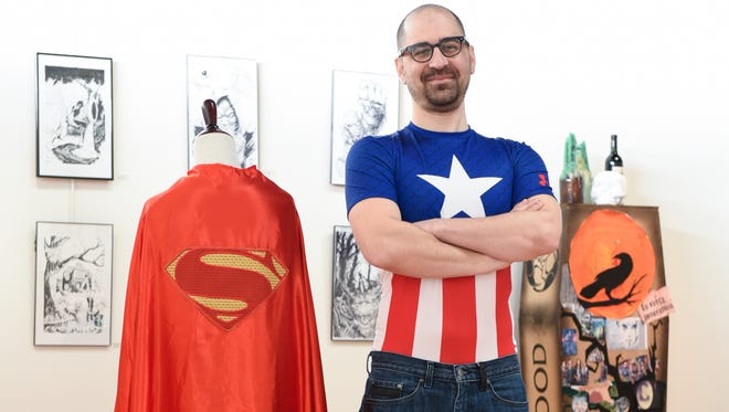 """Galactic Con organizer Joe Manzo at the """"Comics, Capes & Corpses"""" art show at the Gilbert W. Perry, Jr. Center for the Arts in Middletown earlier this week."""