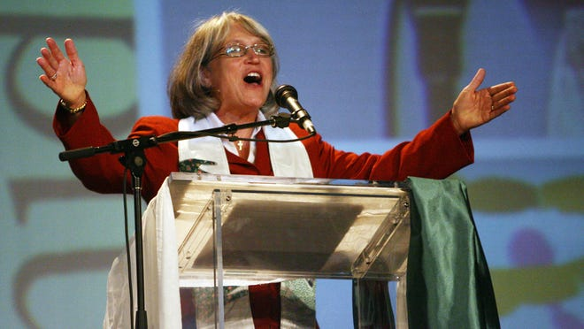 "Dr. Sharon E. Watkins, General Minister and President of the Christian Church (Disciples of Christ), gives the benediction at the evening worship service at the 2009 General Assembly for the church at the Convention Center in Downtown Indianapolis on Aug. 1, 2009. The church said on April 1, 2015, that it is relocating its 2017 annual convention from Indianapolis because of the passage last week of the ""religious freedom"" law."