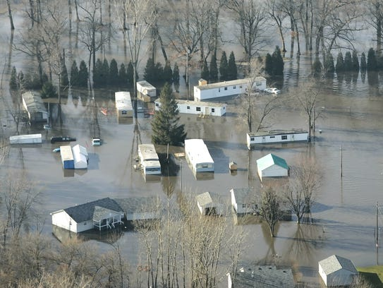 FILE-Flooding in Monon in White County on Wednesday