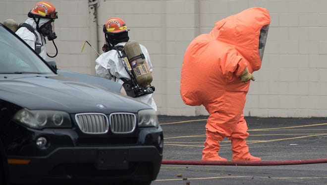 Wayne County HAZMAT works a chemical situation at Hughes Electronics in Livonia.
