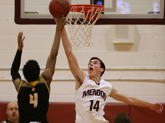 THE PHOTO: Mendon's Daniel Cook (14) gets the block on this shot by Athena's Kelvin Reaves Jr. FROM JAMIE: Sometimes I find it more challenging to shoot the defensive side of the game when covering basketball. It doesn't always work out, but when it does, it can make for interesting photos.  For those who care about the technical side of this image, it was shot with a 300mm f/2.8 lens from the opposite end of the court.