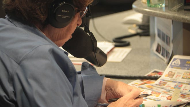 Volunteer Rose Dreyer reads grocery ads over the radio for a program on Sun Sounds in Tempe, Arizona on Dec. 9, 2015.