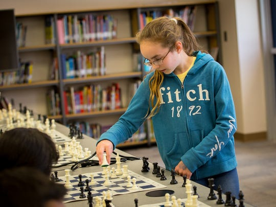 One of New Mexico's highest rated chess champions, 11-year-old Camino Real Middle School 6th-grader Sophia Moore, plays 8 games of chess simultaneously against students from Loma Heights Elementary School in Loma's library, April 29, 2016.