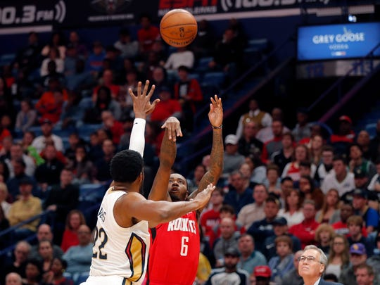 Houston Rockets forward Gary Clark (6) shoots against New Orleans Pelicans forward Derrick Favors (22) in the first half of an NBA basketball game in New Orleans, Sunday, Dec. 29, 2019. (AP Photo/Gerald Herbert)