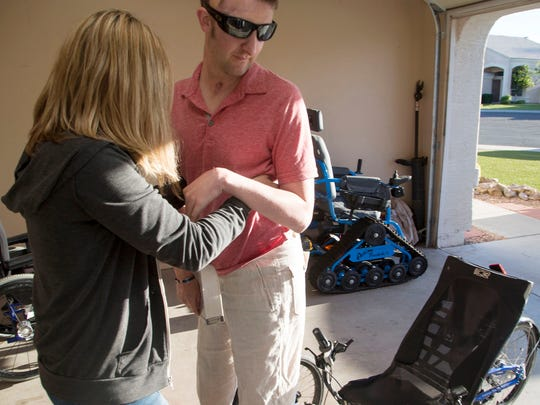 Cory Remsburg, gets help from Nicole Thomas, a Certified