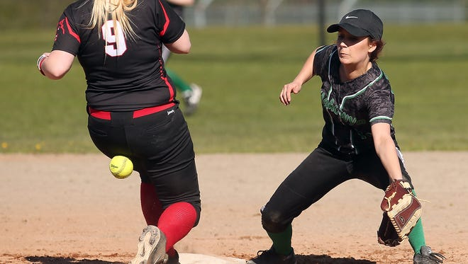 A throw to second, intended for Klahowya's Jessica Cyr, instead hit Coupeville's Tiffany Briscoe during a stolen base attempt on Friday. Briscoe was safe on the play. Coupeville won the Olympic League Class 1A game 5-2.