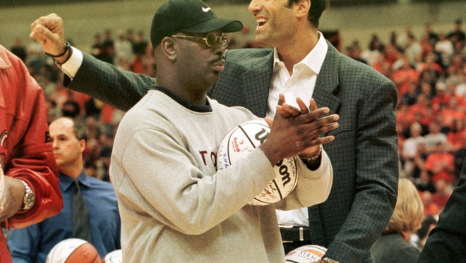 """Former Syracuse players Dwayne Washington, left, and Rony Seikaly take part in ceremonies honoring the school's """"All-Century"""" team on Feb. 27, 2000 at the Carrier Dome."""