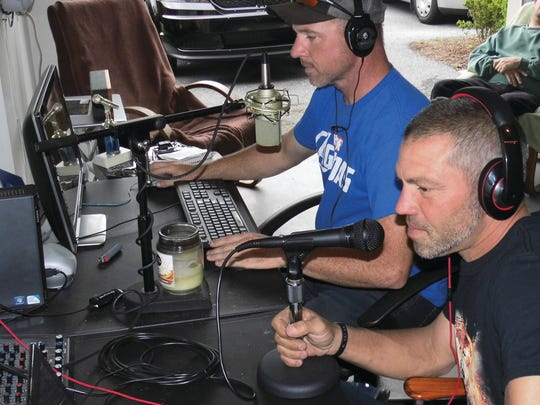 Jaime Eisenhour (right) and co-host Rich Troxel prepare for Monday night's Uncharted Kaos broadcast on rockrageradio.com.