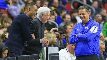 Kentucky's John Calipari smiles as former Duke player Grant Hill and TV announcer Bill Rafferty laugh during the Wildcats' practice session Wednesday afternoon at Wells Fargo Arena in Des Moines before Thursday's NCAA tournament game.