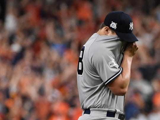 New York Yankees relief pitcher Tommy Kahnle reacts after giving up a home run to Houston Astros' Jose Altuve during the fifth inning of Game 7 of baseball's American League Championship Series Saturday, Oct. 21, 2017, in Houston. (AP Photo/Eric Christian Smith)
