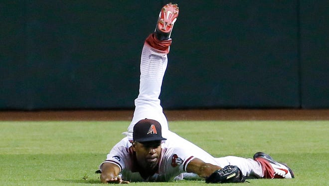 Arizona Diamondbacks center fielder Michael Bourn (1) makes a diving catch with bases loaded to end the 8th inning of their MLB game Monday, June 13, 2016 in Phoenix,  Ariz.