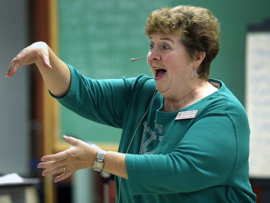 Fox Valley Chorus assistant director Sheila Koplitz of Green Bay leads the group in a vocal warm-up at the start of its rehearsal Sept. 29 at Grace Lutheran Church in Appleton. Koplitz, a retired high school music teacher, has been singing in Sweet Adelines International groups in Northeastern Wisconsin for nearly 40 years.