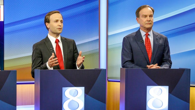GOP gubernatorial candidates Lieutenant Governor Brian Calley, left, and Attorney General Bill Schuette participate in a televised debate at the WOOD TV8 studios, in Grand Rapids on May 9.