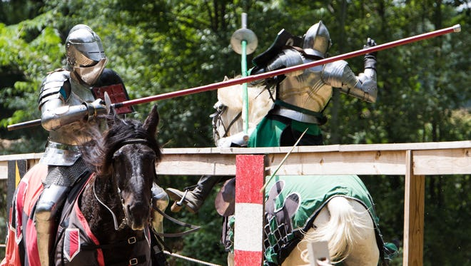 Two knights joust at the BlackRock Medieval Fest.