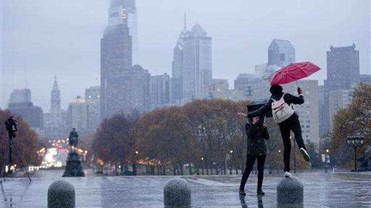 FILE - In this Nov. 17, 2014, file photo, young women snap photos of them selves at the Philadelphia Museum of Art during a rainy afternoon in Philadelphia. Lonely Planet gave some love to the City of Brotherly Love on Tuesday, Feb. 9, 2016, ranking Philadelphia the No. 1 place to visit in the U.S. in 2016.