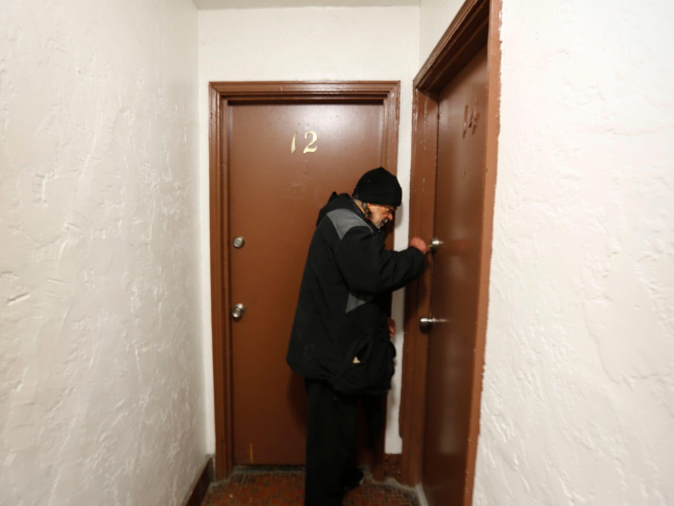 Jonathan Kovac enters his new apartment after being
