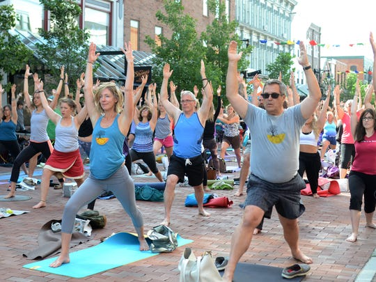 More than 100 people participated in the annual Church Street Yoga event on Church Street in Burlington on Sunday.