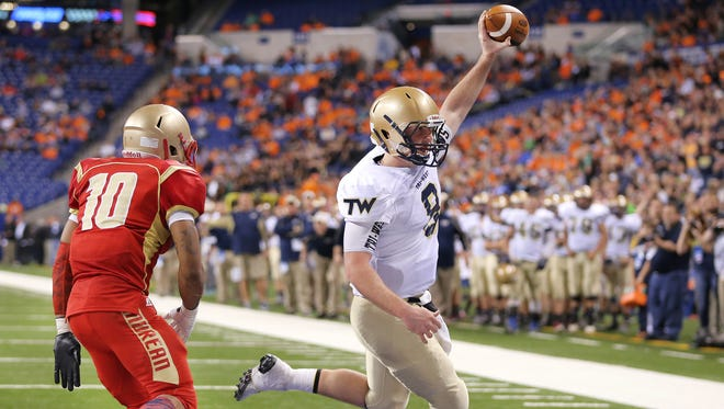 Tri-West quarterback Jake Hendershot celebrated in 2014 as he ran in the final touchdown of the game over Andrean. Tri-West defeated Andrean 49-27 in the IHSAA Class 3A State Football Finals.