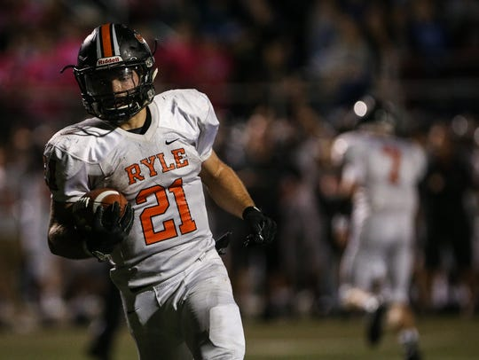 Running back Jacob Chisholm makes it 34-17, Ryle, on