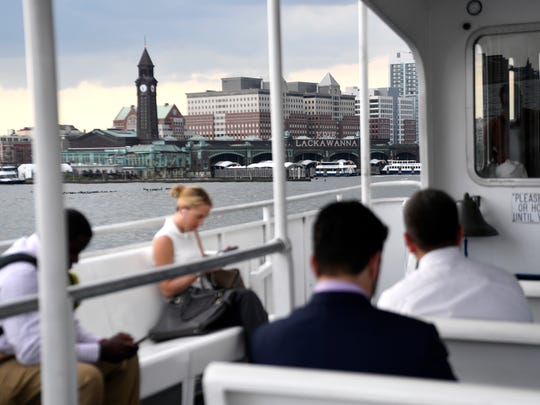 Commuters ride a NY Waterway ferry from the South Street