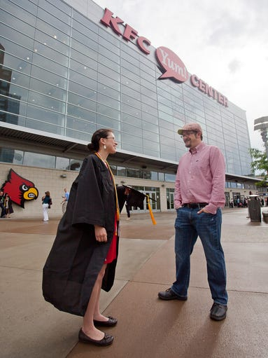 Jennifer Siow and Carl Cloyed during the University of Louisville 2014 Spring Graduation at the KFC Yum! Center in Louisville, KY. May 10, 2014