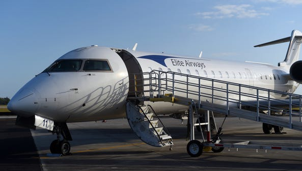 An Elite Airways plane sits on the tarmac at the Vero