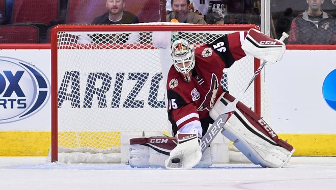 Nov 10, 2016; Glendale, AZ, USA;  Coyotes goalie Louis Domingue (35) makes a save during the second period against the Jets at Gila River Arena.