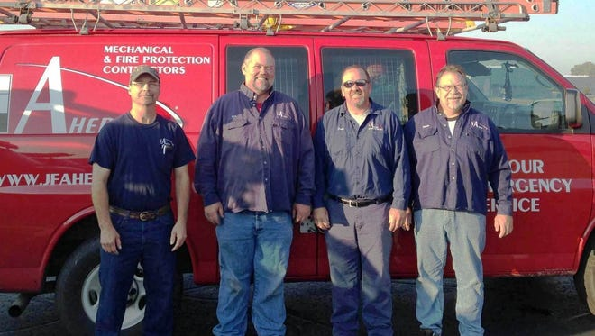 """Ahern's mechanical service technicians who volunteered their time in the Project """"Heat's On"""" program on Sept. 27 include, from left: Rodney Kudrna, Kirk Rademaker, Dean Miller and Dennis Fiecko."""