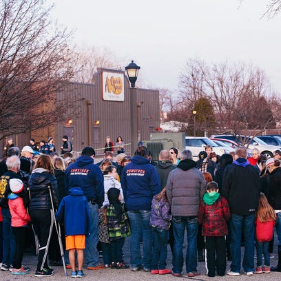Four days after the Kalamazoo shooting, strangers joined